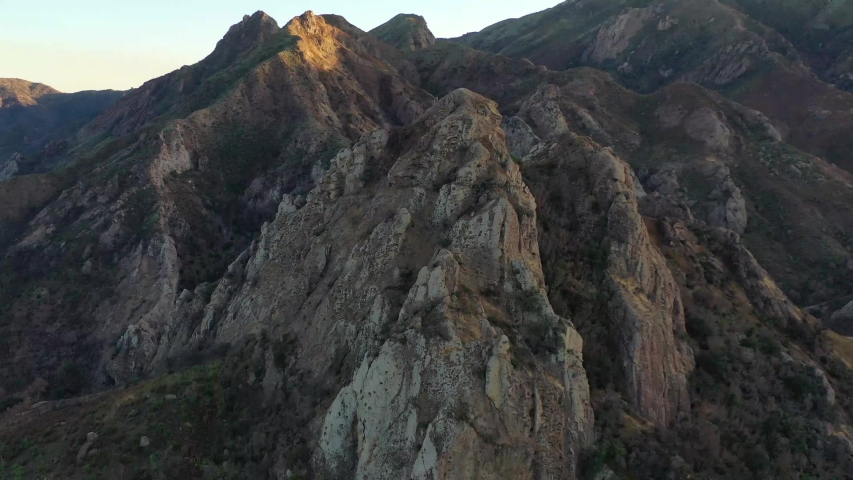 Spectacular aerial video of Malibu Creek State Park, California, at sunset, drone 4k footage. | Shutterstock HD Video #1042169296
