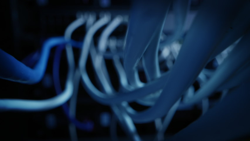 Close-up Macro Shot: Ethernet Cables Connected to Router Ports. Telecommunications: RJ45 Device Connectors Plugged into Modem Hubs. Immersive POV First Person Zoom in Camera Moving Between Cables | Shutterstock HD Video #1042199242