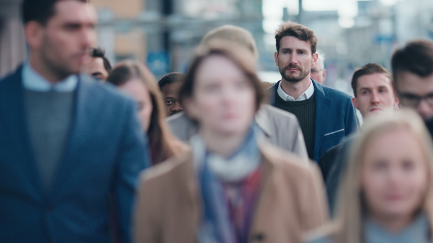 Diverse and Multicultural Office Managers and Business People Commute to Work in the Morning or from Office on Foot. Pedestrians are Dressed Smartly. Successful People Walking in Downtown.   Shutterstock HD Video #1042199398