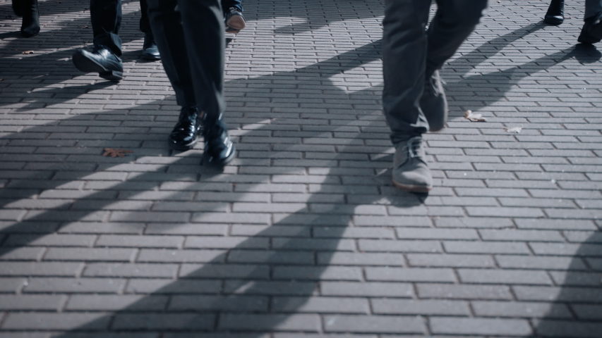 Close Up Leg Shot of a Business People Commuting to the Office on Foot. Managers and Businessmen Walk on a Crowded Pedestrian Street. People Dressed Smart. Cold Light. | Shutterstock HD Video #1042199407
