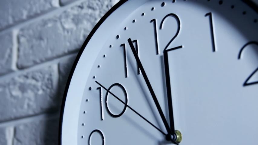 Office Clocks on white wall | Shutterstock HD Video #1042222501