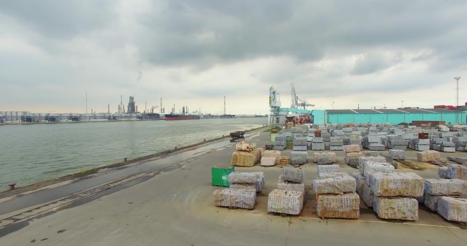 Antwerp / Belgium - 08 15 2017: Drone video of a dock in the port of Antwerp
