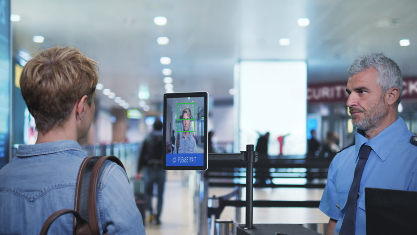face detection system woman goes through the facial recognition control at airport security check Royalty-Free Stock Footage #1042232839