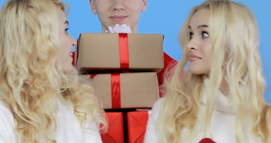 Blonde girls make an order for gifts in the online store. Instant Christmas Gift Delivery. Royalty-Free Stock Footage #1042252942