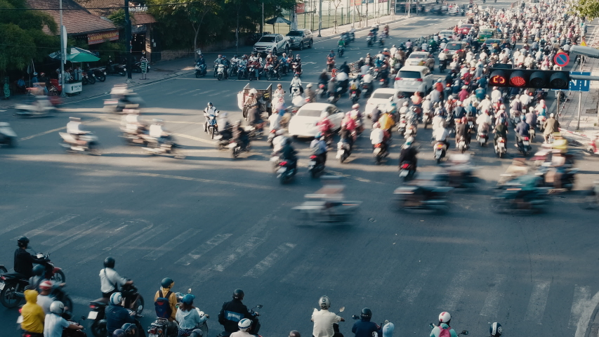 Stock 4k. Time lapse or timelapse traffic from morning to night in Ho Chi Minh city, Vietnam. Multiple scenes time lapse footage of people, life, traffic from day to evening in the financial district