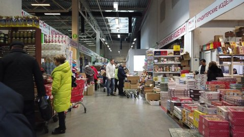 MOSCOW, RUSSIA - 23 NOVEMBER 2019: People walk around the supermarket in search of the right products. People in the food market.