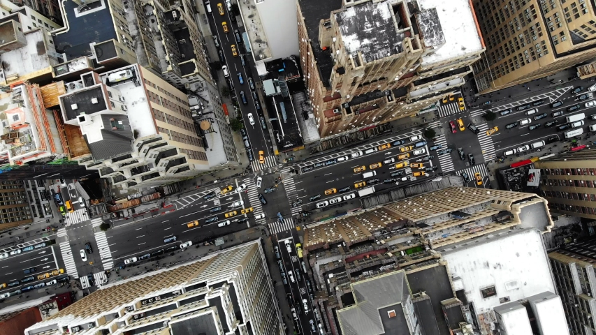 New York, United States. October 28, 2018. Aerial top view of downtown building roofs. Bird's eye view from helicopter of cityscape metropolis infrastructure, traffic cars,yellow cabs,crossing streets