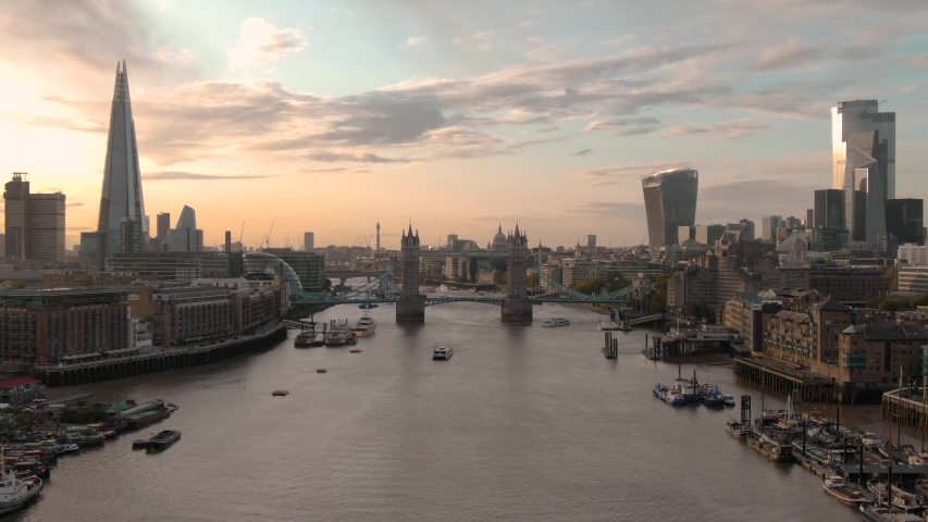 Aerial view of City of London Skyline, Tower Bridge and Thames River at sunset in London #1042318171
