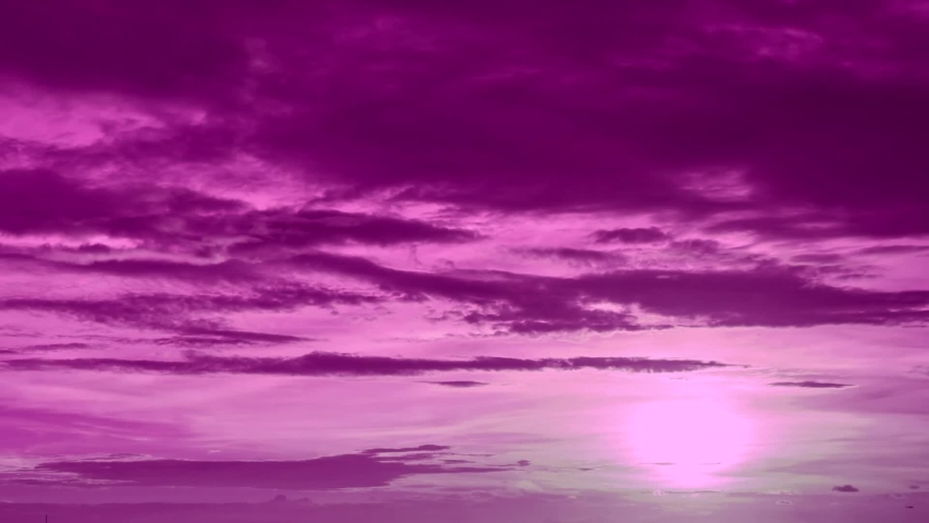 TIME LAPSE PINK, PURPLE CLOUDS IN AUTUMN RAINY WEATHER. Very nice fast moving big, formating mass in horizon. #1042326286