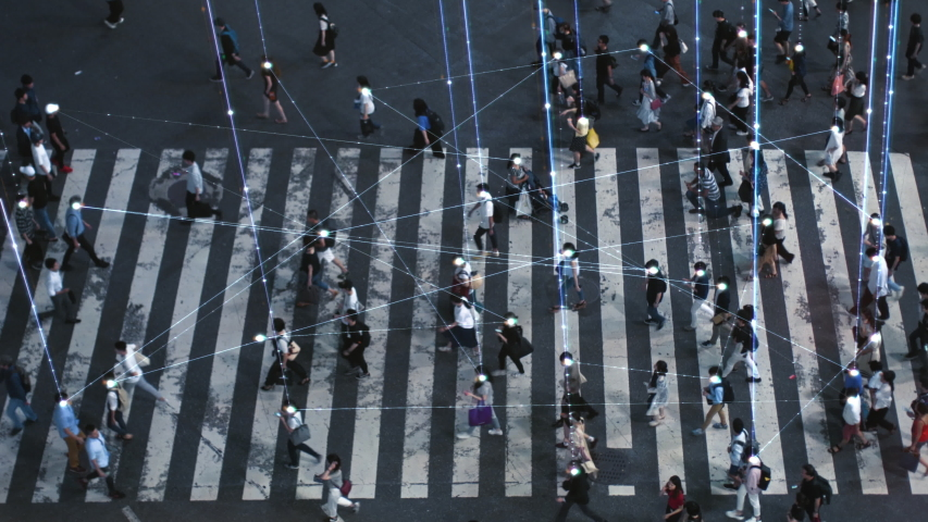 High Angle Shot of a Crowded Pedestrian Crossing in Big City. Augmented Reality Shows Visual Representation of Connected People with the Internet World, Technology Around Us and Wi-Fi  Wave Network. Royalty-Free Stock Footage #1042328680