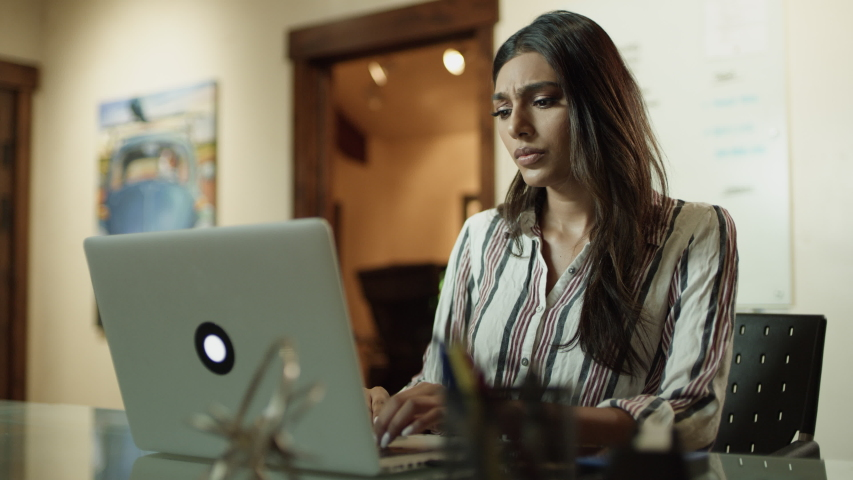 Close up of woman with headache typing on laptop then closing lid and leaving / Cedar Hills, Utah, United States | Shutterstock HD Video #1042330654