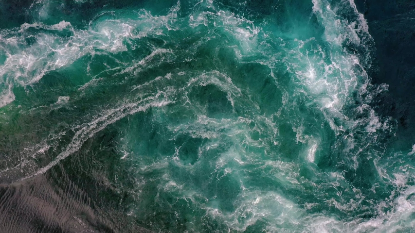Waves of water of the river and the sea meet each other during high tide and low tide. Whirlpools of the maelstrom of Saltstraumen, Nordland, Norway Royalty-Free Stock Footage #1042350451
