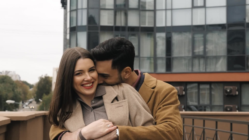 A couple in love walks around the city and enjoys each other's company | Shutterstock HD Video #1042388152