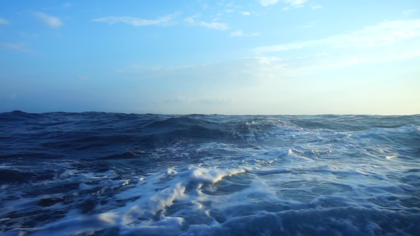 Slow motion video of strong waves in deep blue Aegean open sea #1042397575