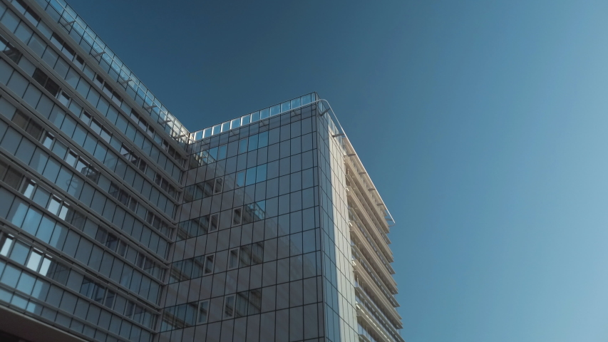 Smooth camera motion between modern capital city buildings in Vilnius, Lithuania. Business district during sunny day. | Shutterstock HD Video #1042408831