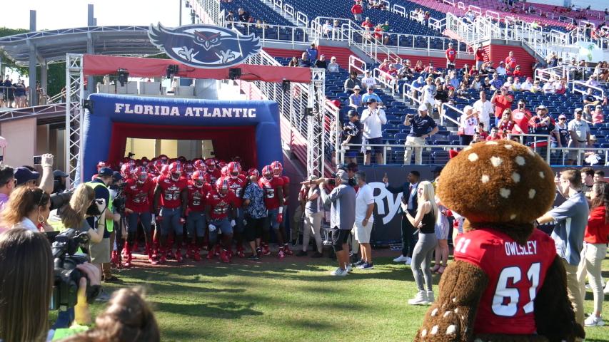 Boca Raton, Florida/USA - December 07, 2019: Florida Atlantic Owls vs UAB Blazers. 2019 Ryan C-USA Football Championship. College Football players on the field at FAU Stadium. Football footage.