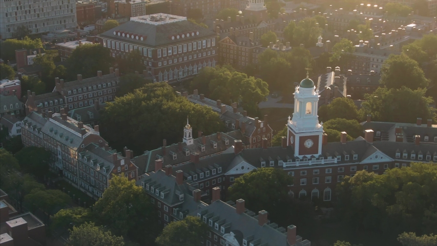 Aerial: flying over Harvard University at sunrise. Boston, Massachusetts, USA. 28 August 2019
