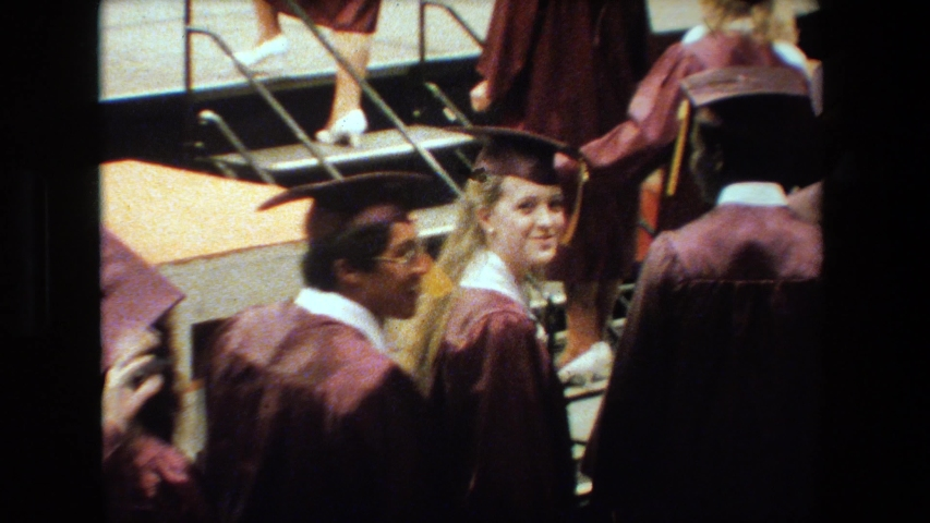 LANSING MICHIGAN-1983: Students Happy To Be Graduating Wave To Friends And Family | Shutterstock HD Video #1042466437