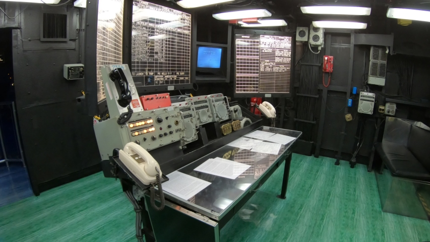 San Diego, Navy Pier, California, USA - JULY 31, 2018: Main battle station with table and maps in operation room of Battleship Midway at San Diego. Was longest-serving aircraft carrier, 1945 to 1992 | Shutterstock HD Video #1042483159
