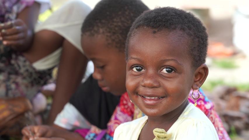 Zanzibar, Tanzania - december 09, 2019 : Young African girl on the street near home in island of Zanzibar, Tanzania, east Africa, close up