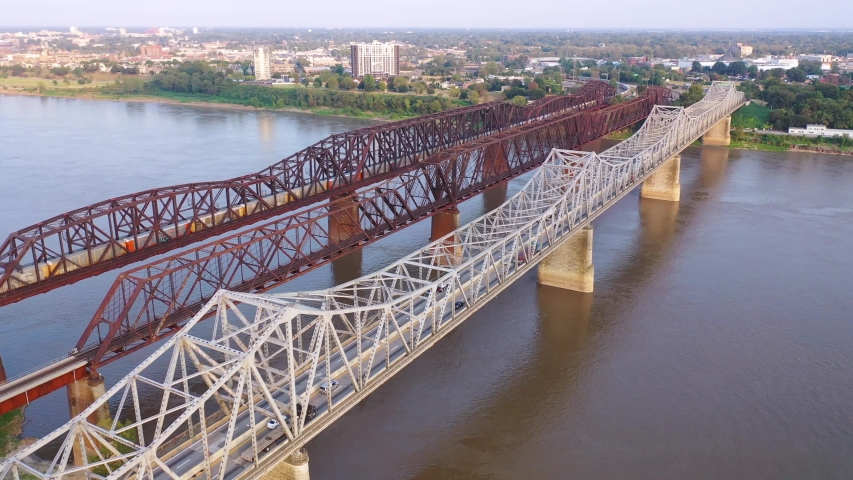 MEMPHIS, TENNESSEE - CIRCA 2010s - Aerial of landmark three steel bridges over the Mississippi River with Memphis, Tennessee background.