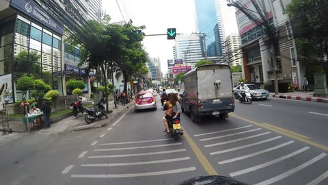 BANGKOK, THAILAND - 16 JUNE 2015: A busy road scene in Bangkok, Thailand with cars, taxi, bus, point of view with motorcycle on the road by gopro camera, Bangkok, Thailand