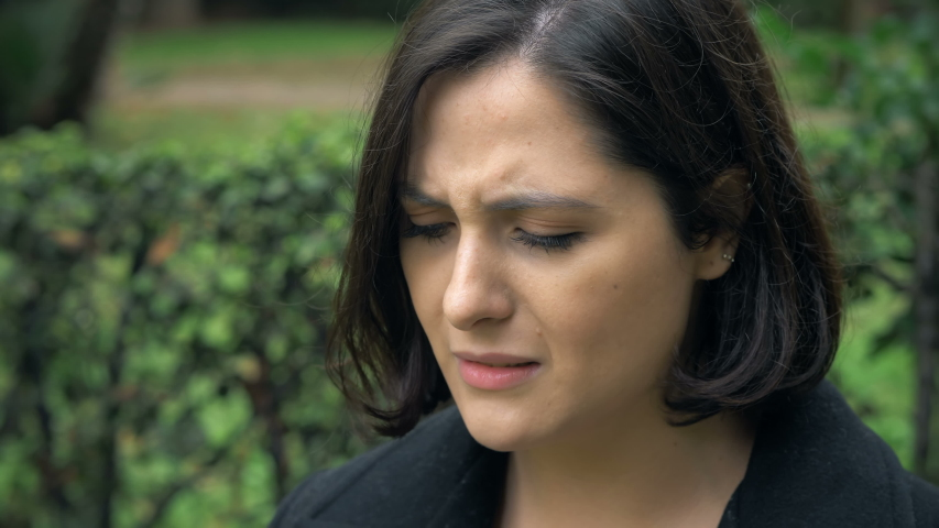 Work problems, dismissal.depressed desperate young business woman crying-outdoor | Shutterstock HD Video #1042504339
