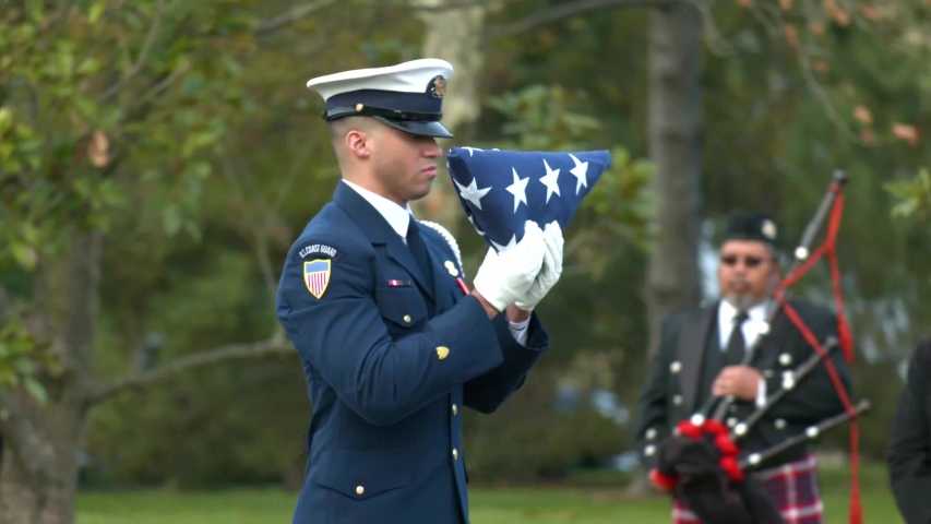 WASHINGTON D.C. - CIRCA 2010s - a patriotic military funeral in Arlington Cemetery, Washington D.C., includes an American flag folding ceremony.