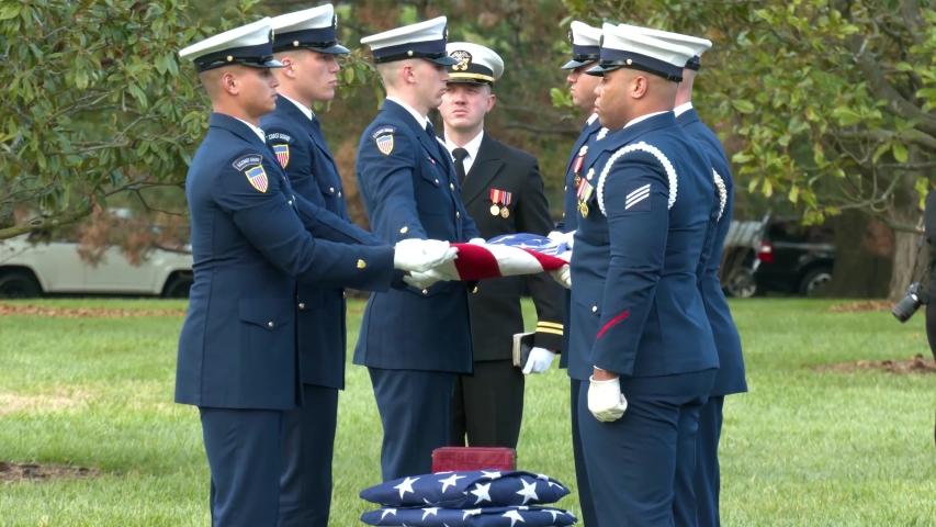 WASHINGTON D.C. - CIRCA 2010s - a patriotic military funeral in Arlington Cemetery, Washington D.C., includes an American flag folding ceremony.