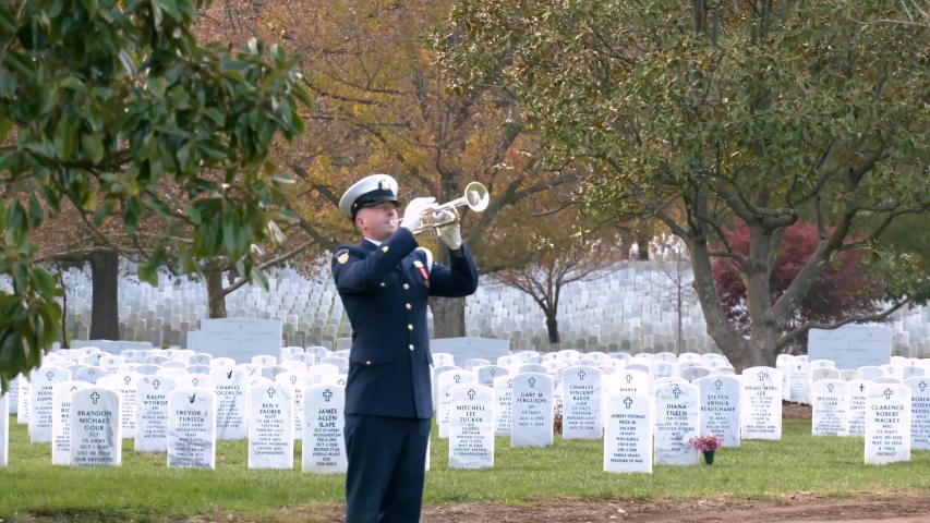 WASHINGTON D.C. - CIRCA 2010s - a patriotic military funeral in Arlington Cemetery, Washington D.C., includes the playing of taps.