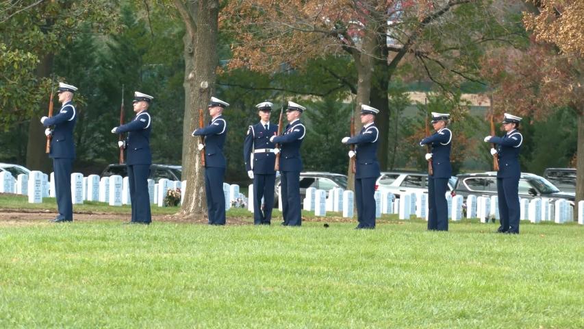 WASHINGTON D.C. - CIRCA 2010s - a patriotic military funeral in Arlington Cemetery, Washington D.C., includes a 21 gun salute.