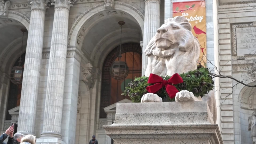 New York, New York, USA - December 5, 2019: The New York Public Library with famous lion Fortitude with a wreath for the Christmas Holiday season.