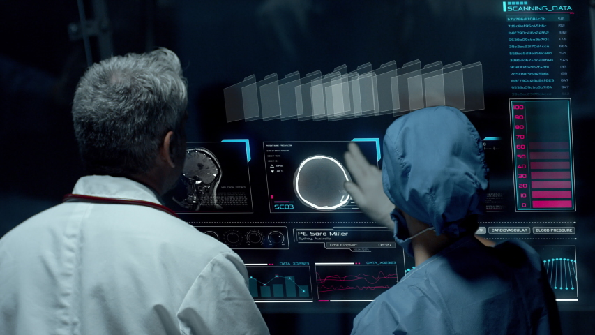 Doctors Interacting on Big Transparent Display Working with Patient Brain Scan Tomography Images and Neural System Data. Neurological Research Center. Royalty-Free Stock Footage #1042568596