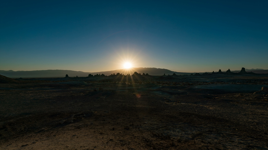 Timelapse of sunrise over tufa towers in distance at Trona Pinnacles in Mojave Desert, California