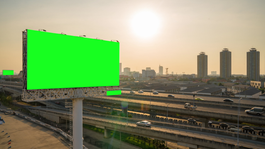 Advertising billboard green screen on sidelines of expressway with traffic at evening, time lapse.  | Shutterstock HD Video #1042594030