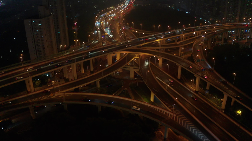 Rising shot shot the huge spectacular elevated highway and  roads, bridges, traffic in Shanghai at night, transportation and infrastructure development in urban China