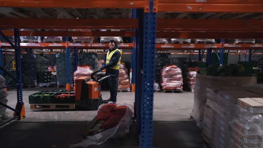 Workers moves on a forklift in a warehouse | Shutterstock HD Video #1042603696