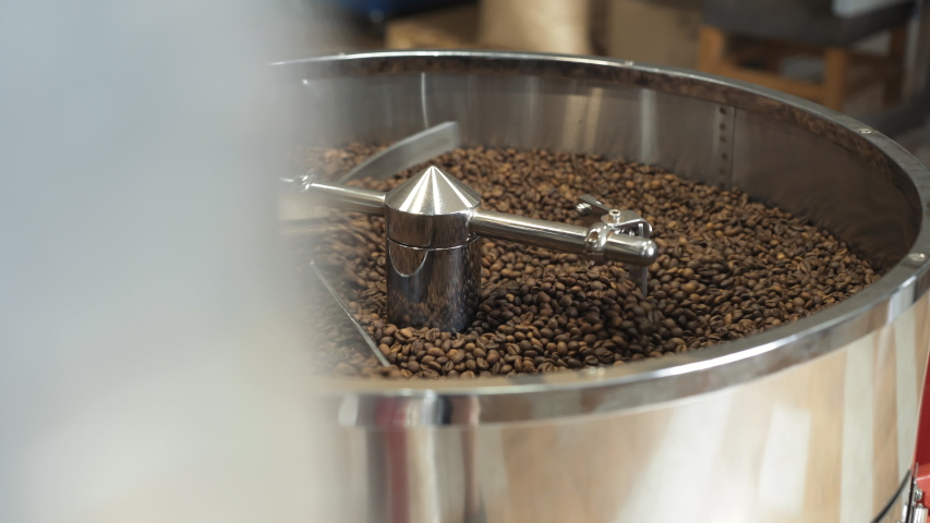 Process of grinding coffee beans in machine. 4K. | Shutterstock HD Video #1042608193
