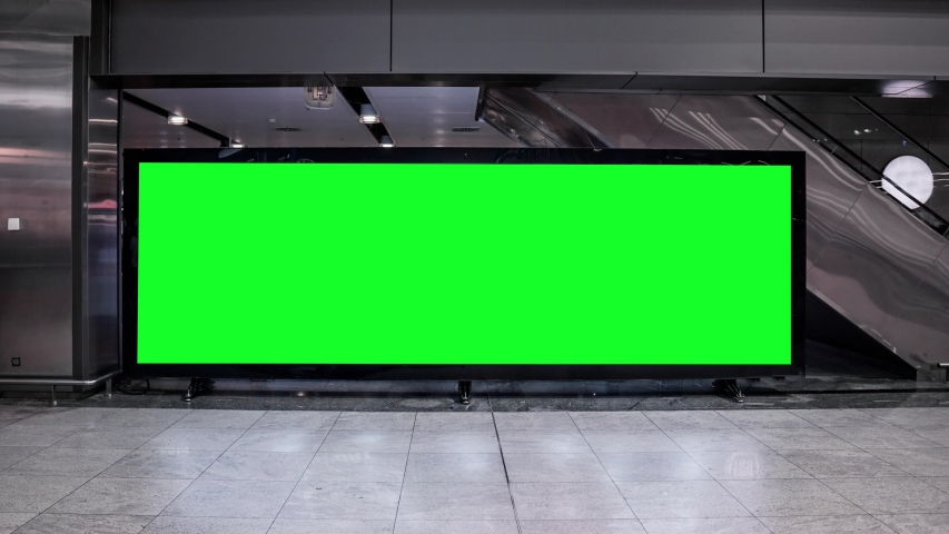 Empty blank widescreen billboard with green screen, alpha channel. Chroma key frame on airport hall, big banner for marketing.  | Shutterstock HD Video #1042621804