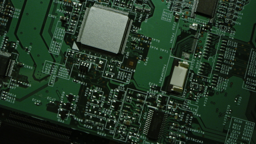 Green Printed Circuit Board, Computer Motherboard Components: Microchips, CPU Processor, Transistors, Semiconductors. Inside of Electronic Device, Parts of Supercomputer. Top View Moving Macro Shot