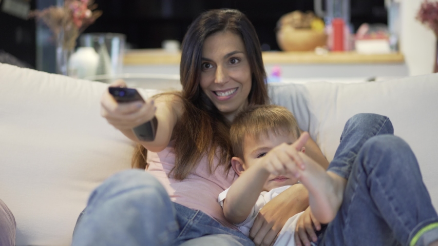 Mother with her children in armchair. | Shutterstock HD Video #1042654981