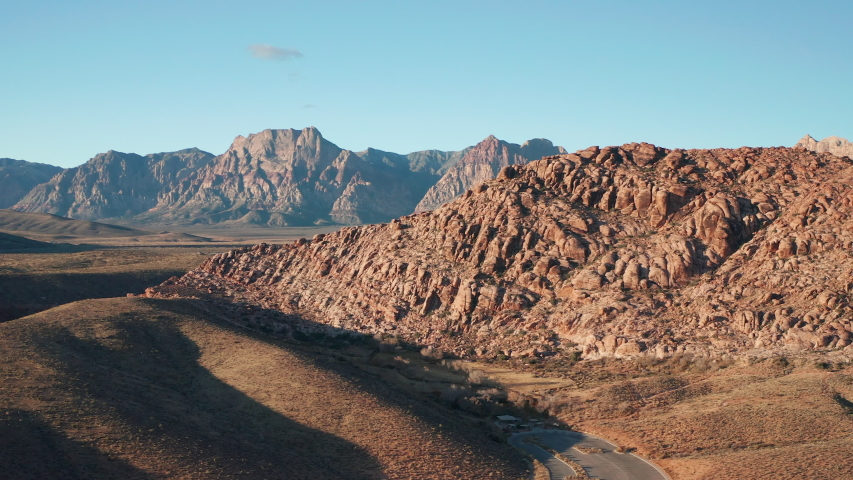 Aerial dolly scenic shot of colorful sandstone cliffs, Red Rock Canyon mountains | Shutterstock HD Video #1042668406