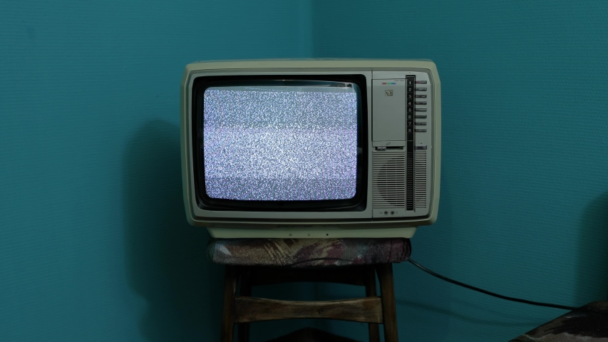 Vintage TV set on a chair in an empty room | Shutterstock HD Video #1042692034