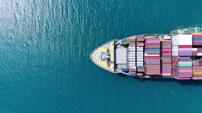 Aerial of cargo ship carrying container and running for export  goods  from  cargo yard port to other ocean concept freight shipping ship . #1042696831