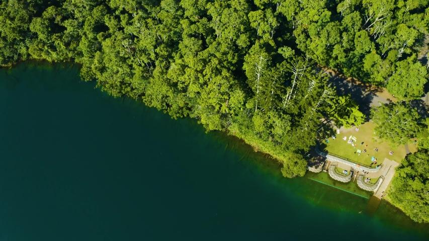 Aerial, beautiful view on Lake Eacham in tablelands in Queensland, Australia | Shutterstock HD Video #1042697317
