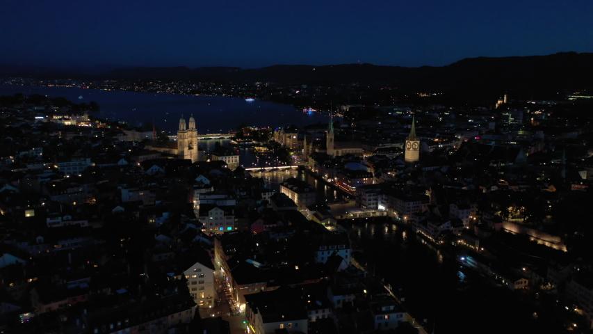 Night illuminated flight over zurich city central district aerial panorama 4k switzerland