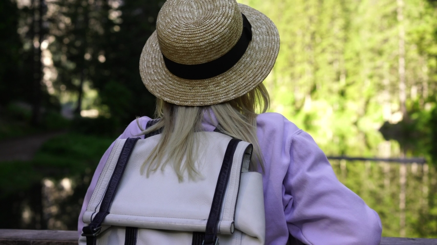 Attractive woman traveler with backpack enjoying hiking tour in mountains, Caucasian hipster girl explore National Park on vacations taking pictures of beautiful scenic via modern cellular phone  | Shutterstock HD Video #1042710193