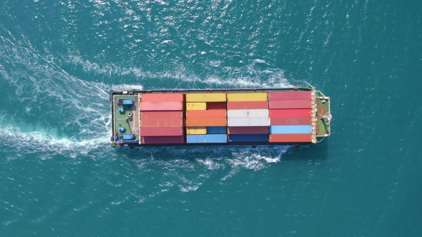 Top down Aerial View of a large container ship sailing at the sea for transporting shipments to other countries   #1042723411