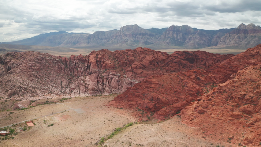 Aerial flying shot of Calico Basin sandstone cliffs, Red Rock Canyon mountains | Shutterstock HD Video #1042723840