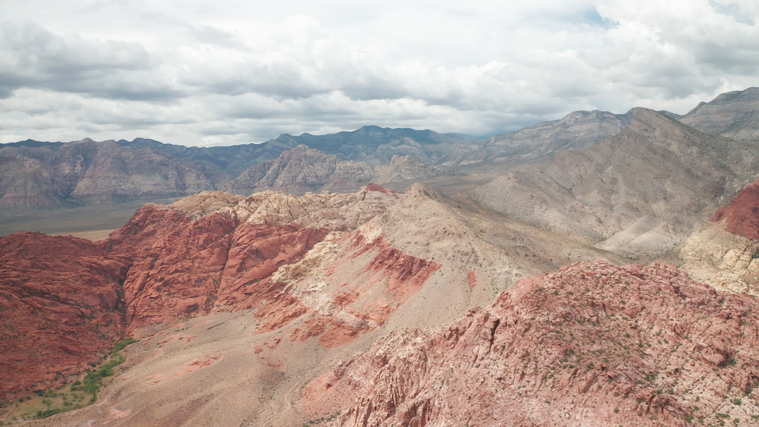 Aerial pan shot of Calico Basin and Red Rock Canyon mountain range and cliffs | Shutterstock HD Video #1042723852